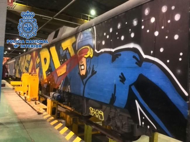 Policia Nacional. grafiti FGV Renfe